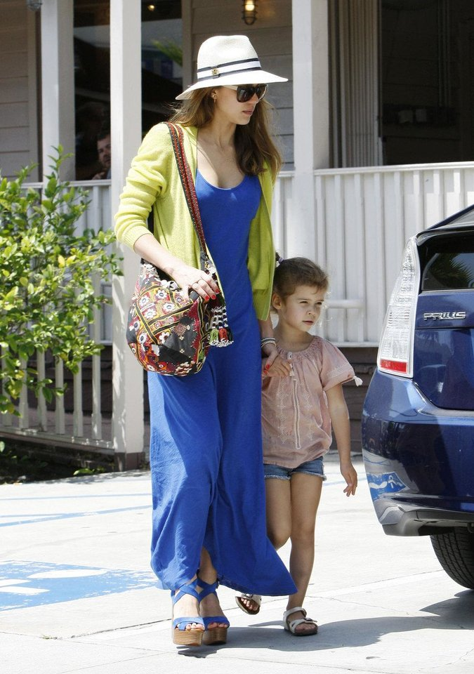 Photo - Jessica Alba recently made an appearance with her daughter for Sunday brunch in L.A. She appeared picture-perfect in a long blue dress, chartreuse cashmere cardigan by Theonne, a shady hat and blue wedges.