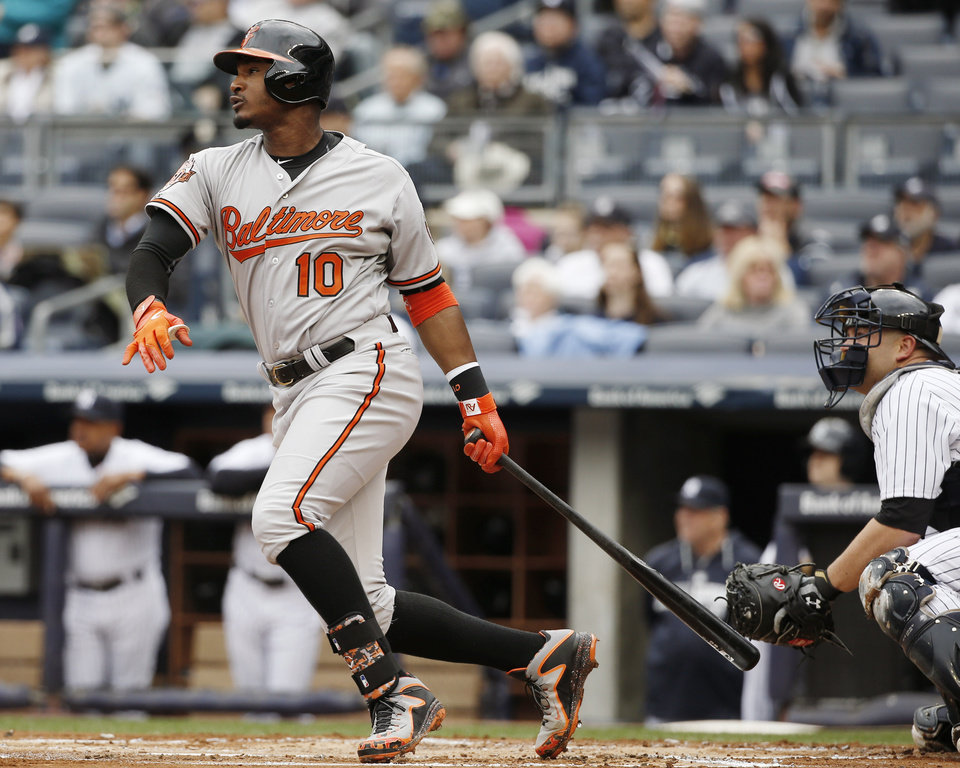 Photo - Baltimore Orioles' Adam Jones follows through on a first-inning, two-run home run in a baseball game against the New York Yankees at Yankee Stadium in New York, Tuesday, April 8, 2014.  (AP Photo/Kathy Willens)