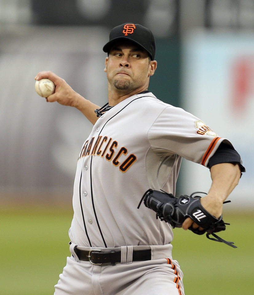 Photo - San Francisco Giants' Ryan Vogelsong works against the Oakland Athletics in the first inning of a baseball game Monday, July 7, 2014, in Oakland, Calif. (AP Photo/Ben Margot)