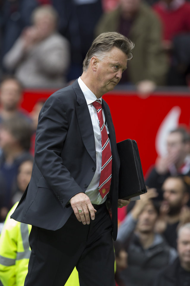 Photo - Manchester United's manager Louis van Gaal walks from the pitch after his team's 2-1 loss to Swansea City in their English Premier League soccer match at Old Trafford Stadium, Manchester, England, Saturday Aug. 16, 2014. (AP Photo/Jon Super)