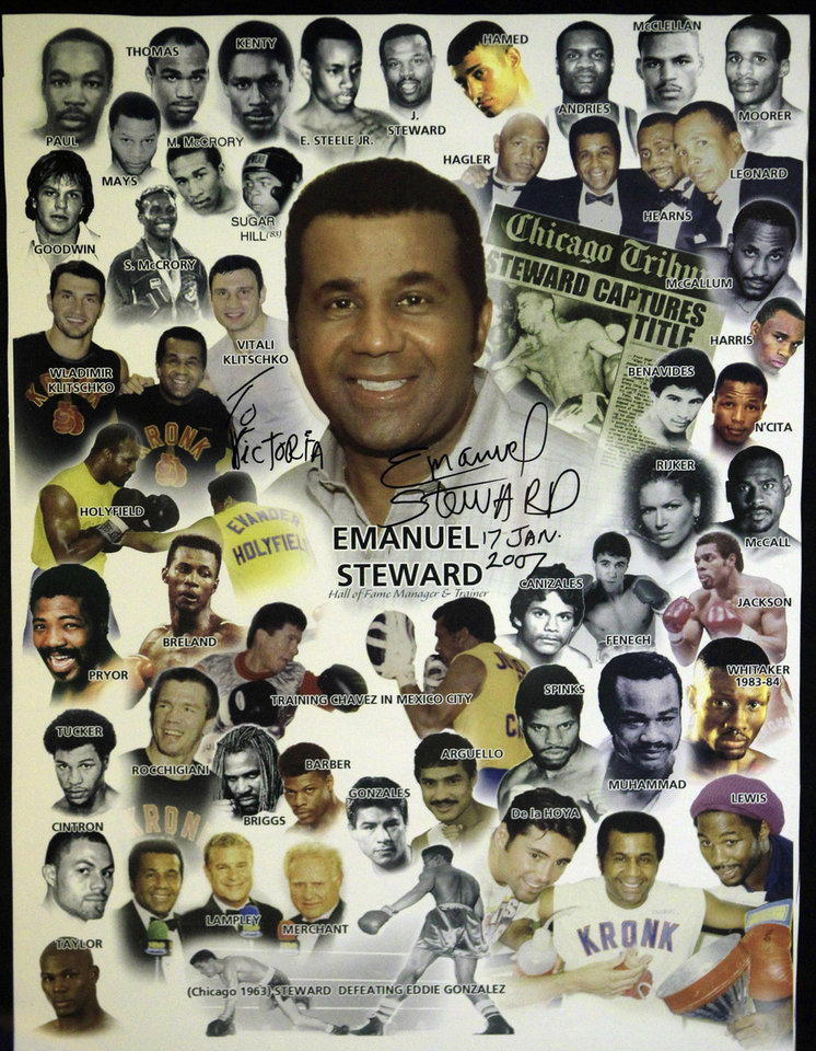 A poster honoring boxing trainer Emanuel Steward and the boxers he trained is seen in the trainer's office in Detroit, Tuesday, Nov. 13, 2012. A funeral service for the late boxing trainer was held Tuesday in Detroit. (AP Photo/Carlos Osorio)