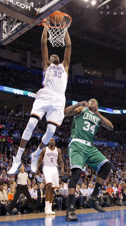 Photo - Oklahoma City Thunder small forward Kevin Durant (35) dunks over Boston Celtics small forward Paul Pierce (34) during the NBA basketball game between the Oklahoma City Thunder and the Boston Celtics at the Chesapeake Energy Arena on Wednesday, Feb. 22, 2012 in Oklahoma City, Okla.  Photo by Chris Landsberger, The Oklahoman