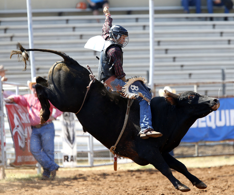 Bo Halford of McLoud, Okla., rides in the bull riding event during day four of the International Youth Finals Rodeo at the Shawnee Expo Center in Shawnee, Okla., Wednesday, July 11, 2012. Photo by Sarah Phipps, The Oklahoman