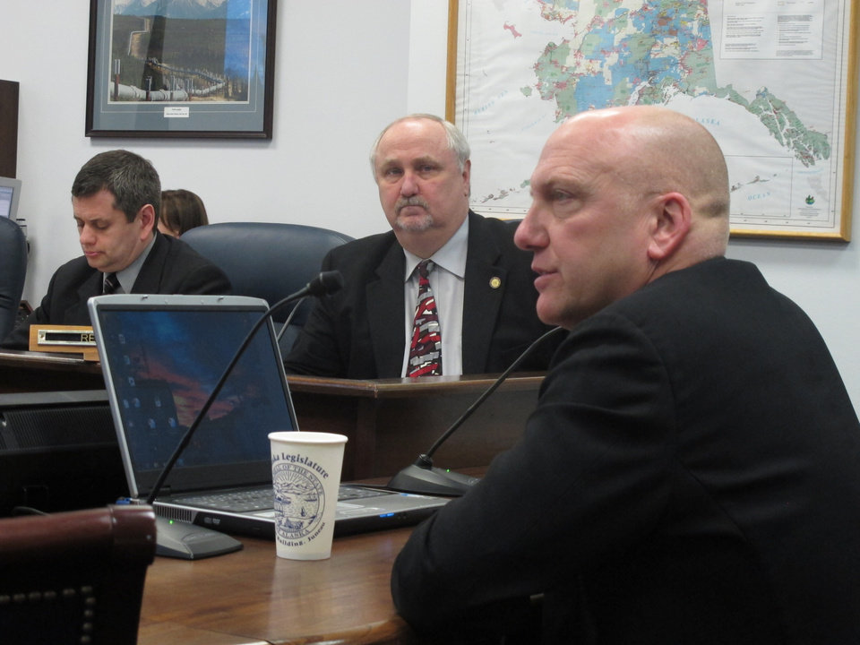 Photo - Bill Armstrong, president of Armstrong Oil and Gas Inc., seated in the foreground, testifies on the governor's oil tax plan before the House Resources Committee on Monday, Feb. 18, 2013, in Juneau, Alaska. Also pictured, from left, are Reps. Chris Tuck, D-Anchorage, and Craig Johnson, R-Anchorage. (AP Photo/Becky Bohrer)