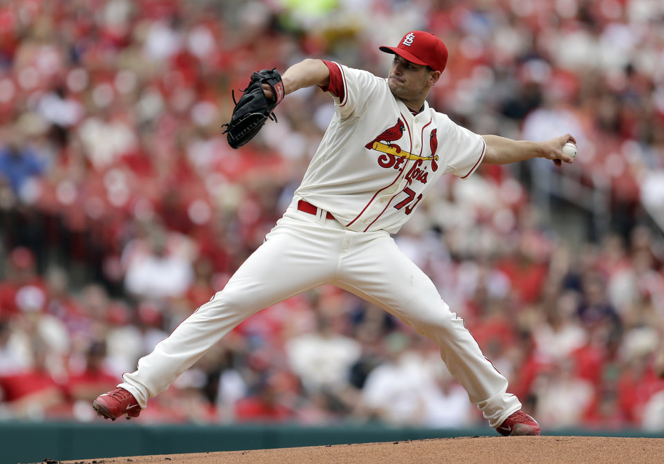 Photo - St. Louis Cardinals starting pitcher Tyler Lyons throws during the first inning of a baseball game against the Pittsburgh Pirates on Saturday, April 26, 2014, in St. Louis. (AP Photo/Jeff Roberson)