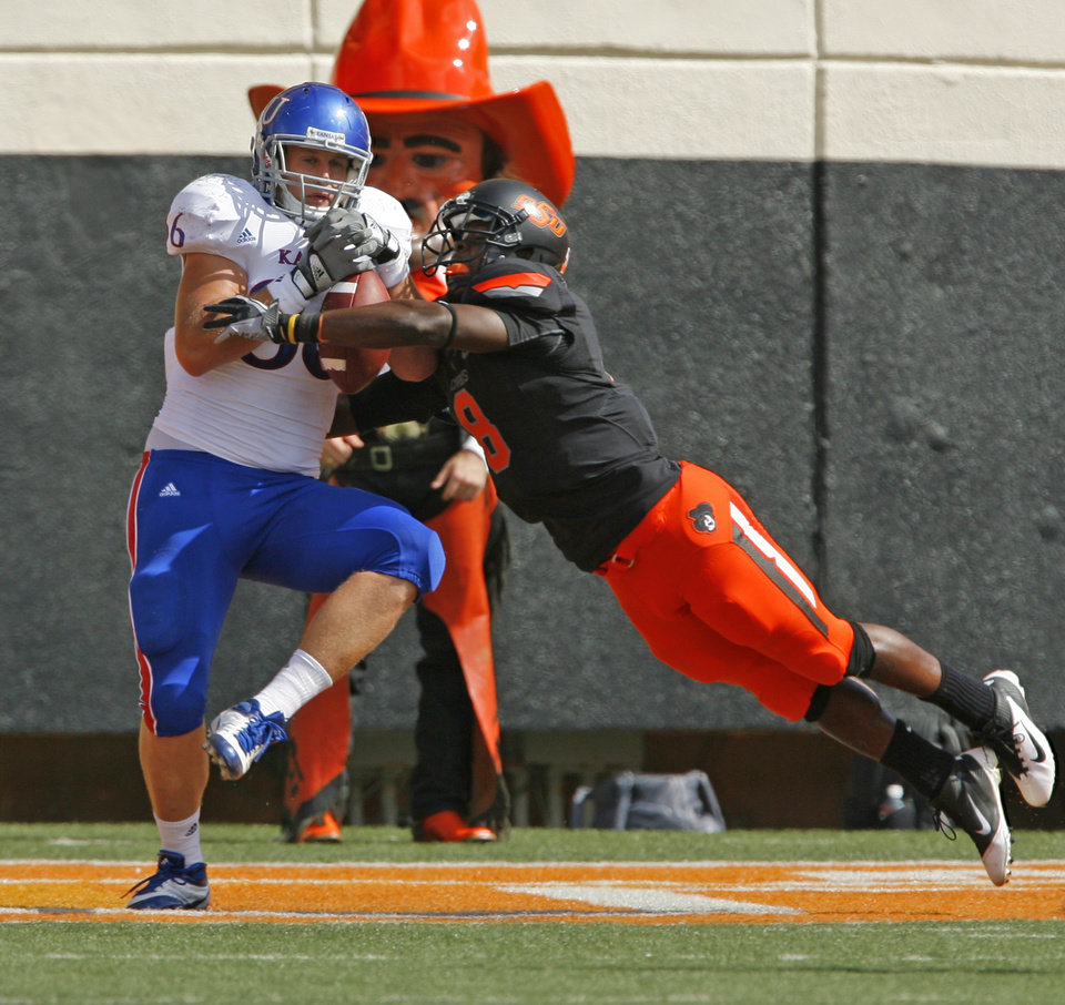 Photo - Kansas' Tim Biere (86) catches a pass in he end zone covered by Oklahoma State's Daytawion Lowe (8) during a college football game between the Oklahoma State University Cowboys (OSU) and the University of Kansas Jayhawks (KU) at Boone Pickens Stadium in Stillwater, Okla., Saturday, Oct. 8, 2011 Photo by Steve Sisney, The Oklahoman