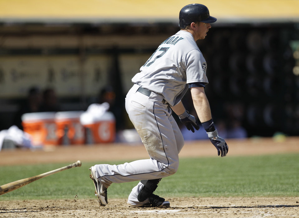 Photo -   Seattle Mariners' Justin Smoak watches his RBI single hit off Oakland Athletics' Tommy Milone in the third inning of a baseball game Sunday, Sept. 30, 2012, in Oakland, Calif. (AP Photo/Ben Margot)