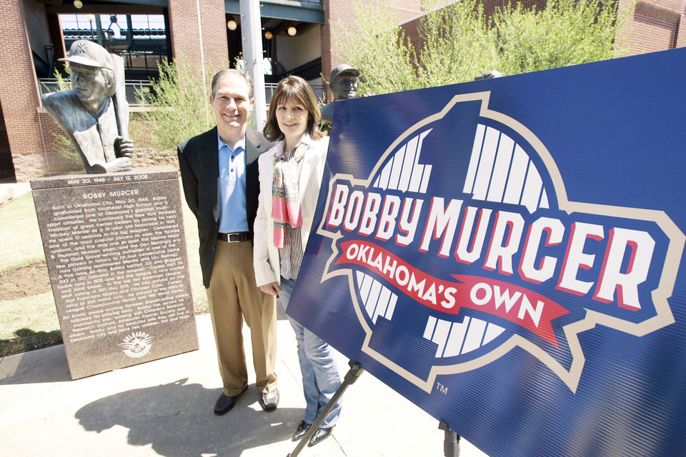 Photo - Oklahoma RedHawks managing partner Scott Pruitt, left, poses with Kay Murcer, the widow of Bobby Murcer, on Tuesday. The RedHawks will retire the No. 1 jersey in honor of Bobby Murcer in a special ceremony Friday at the Bricktown Ballpark Photo by Steve Gooch, The Oklahoman
