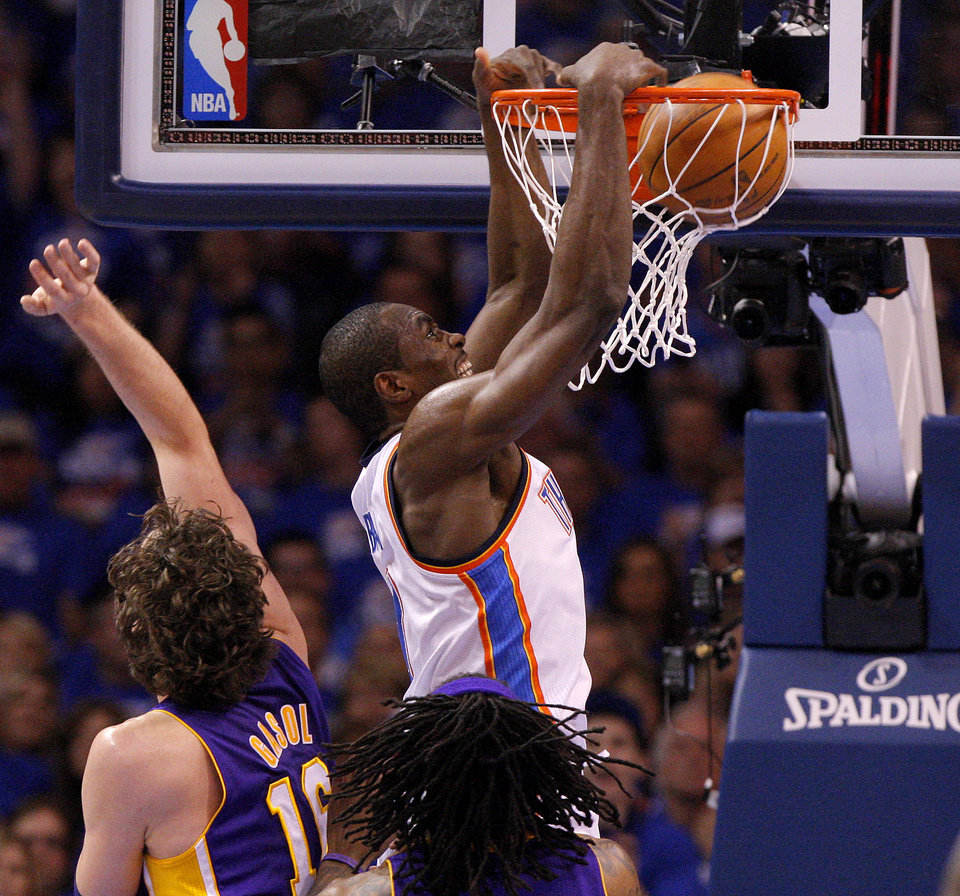 Oklahoma City's Serge Ibaka (9) dunks the ball beside Los Angeles' Pau Gasol (16) during Game 5 in the second round of the NBA playoffs between the Oklahoma City Thunder and the L.A. Lakers at Chesapeake Energy Arena in Oklahoma City, Monday, May 21, 2012. Photo by Bryan Terry, The Oklahoman