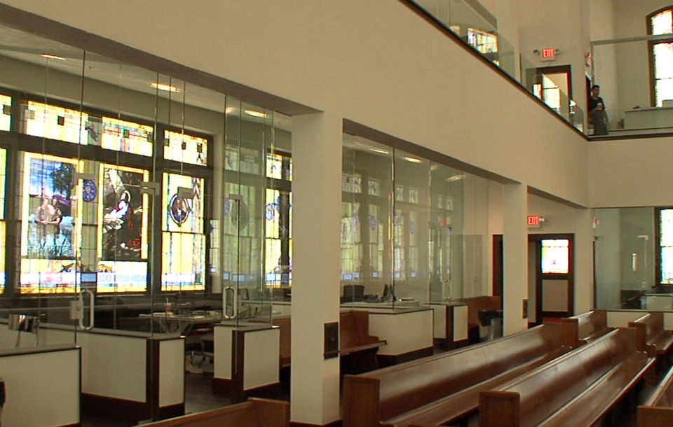 Glass-walled offices surround the former sanctuary after the renovation of Calvary Baptist Church, which was transformed into a law office while retaining much of its former architectural character. Photo by Tim Money, NewsOK.com  <strong>Tim Money -   </strong>