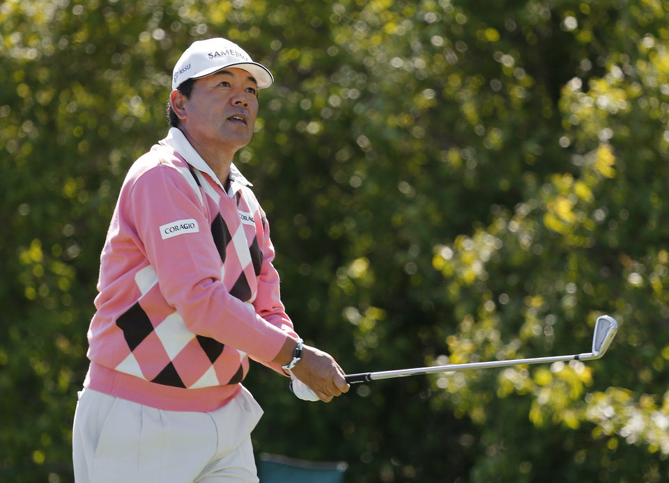 Photo - Kiyoshi Murota, of Japan, hits a tee shot on the fourth hole during the second round of the 75th Senior PGA Championship golf tournament at Harbor Shores Golf Club in Benton Harbor, Mich., Friday, May 23, 2014. (AP Photo/Paul Sancya)