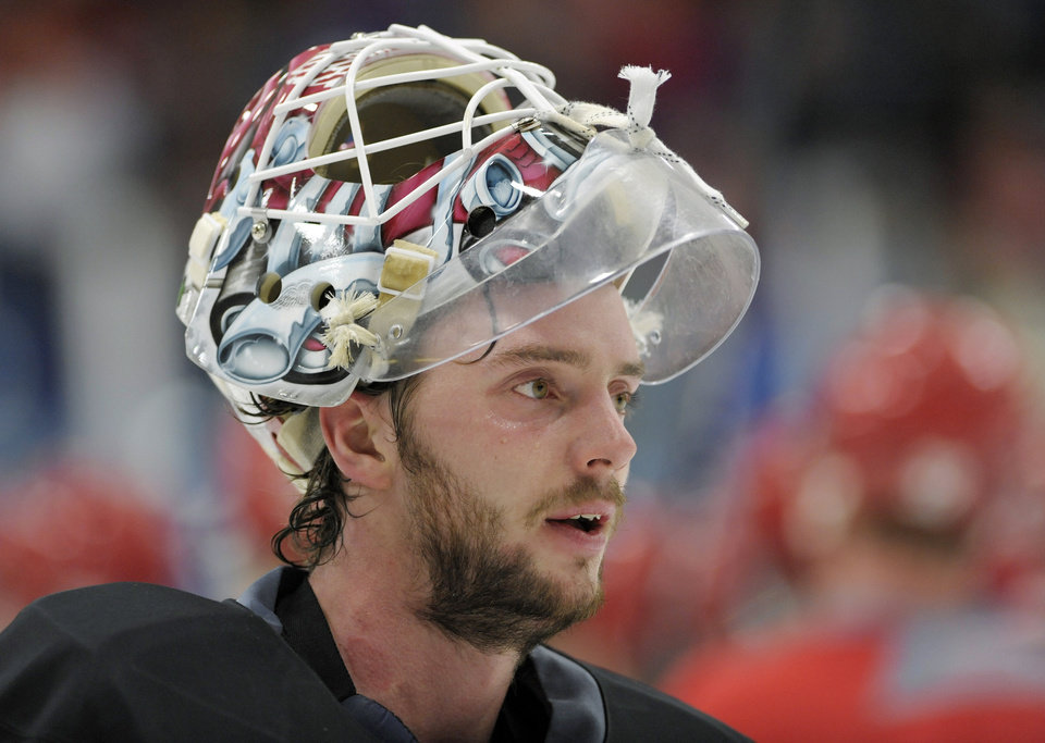 New Detroit Red Wings goalie Jonas Gustavsson takes a breather during the NHL hockey team's training camp Sunday, Jan. 13, 2013, in Plymouth, Mich. (AP Photo/The Detroit News, David Guralnick) DETROIT FREE PRESS OUT  HUFFINGTON POST OUT  MAGS OUT