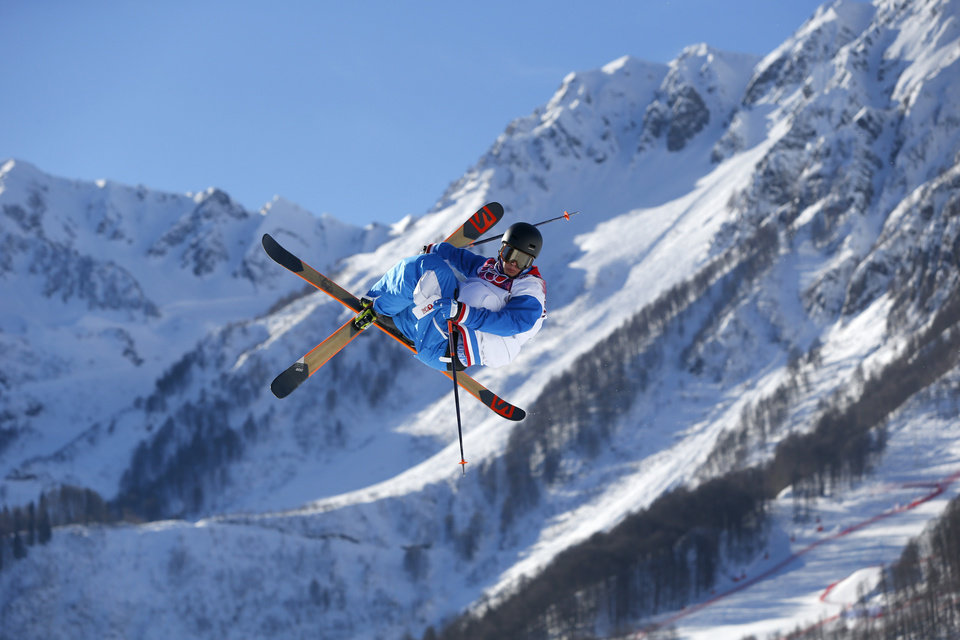 Photo - France's Antoine Adelisse competes in the men's ski slopestyle qualifying at the Rosa Khutor Extreme Park, at the 2014 Winter Olympics, Thursday, Feb. 13, 2014, in Krasnaya Polyana, Russia. (AP Photo/Sergei Grits)