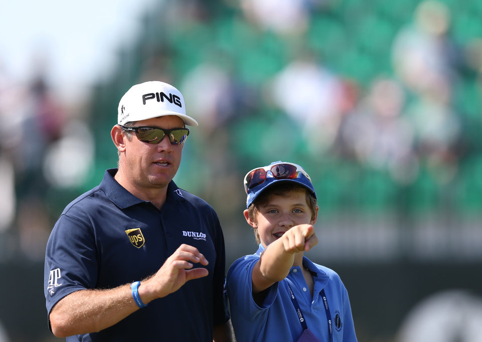 Photo - Lee Westwood of England and his son Sam look along the 4th fairway during a practice round ahead of the British Open Golf championship at the Royal Liverpool golf club, Hoylake, England, Tuesday July 15, 2014. The British Open Golf championship starts Thursday July 17. (AP Photo/Scott Heppell)