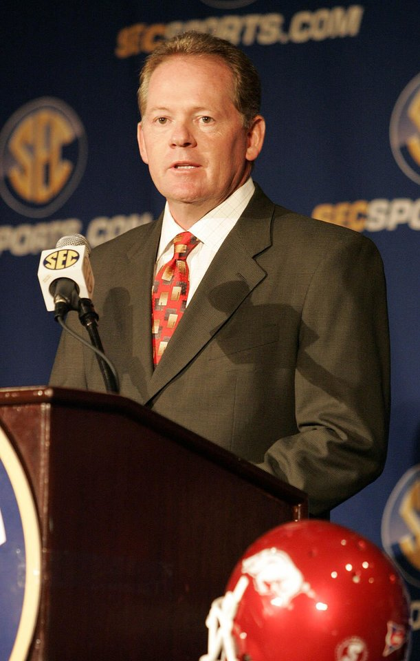 Photo -   This July 22, 2009 file photo shows Arkansas football coach Bobby Petrino speaking to the media during a news conference at the SEC Media Days in Hoover, Ala. A person familiar with the situation says Petrino is out as the football coach at Arkansas. The person spoke to The Associated Press on the condition of anonymity, and the university has scheduled a Tuesday April 10, 2012 news conference with athletic director Jeff Long. (AP Photo/ Butch Dill,File)