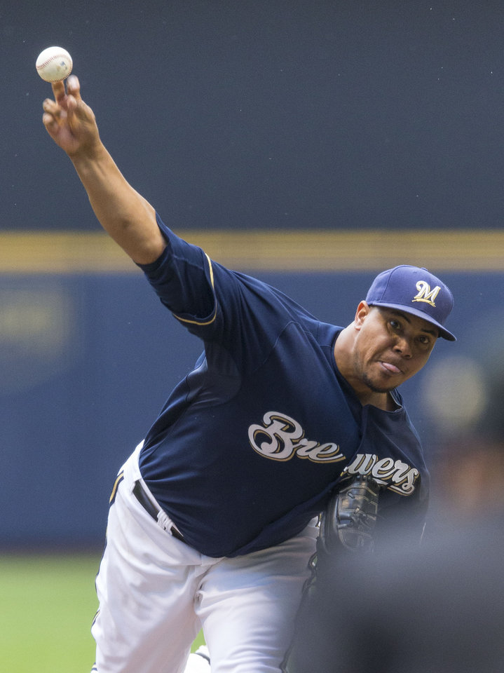 Photo - Milwaukee Brewers' Wily Peralta pitches to a St. Louis Cardinals batter during the first  inning of a baseball game Sunday, July 13, 2014, in Milwaukee. (AP Photo/Tom Lynn)