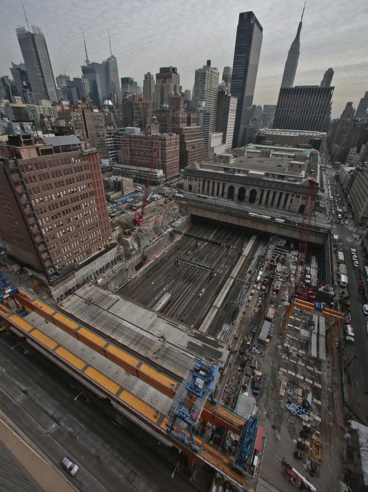 Photo - This photo shows ongoing construction of  Brookfield Manhattan West project site over rail tracks used by commuter trains at Penn Station, Wednesday April 16, 2014 in New York.  A giant crane called