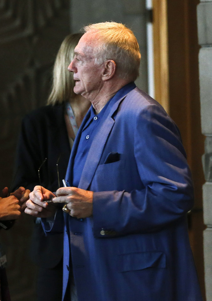 Photo - Dallas Cowboys owner Jerry Jones walks out after the morning owners' session at the NFL football annual meetings, Tuesday, March 19, 2013, in Phoenix. (AP Photo/Ross D. Franklin)