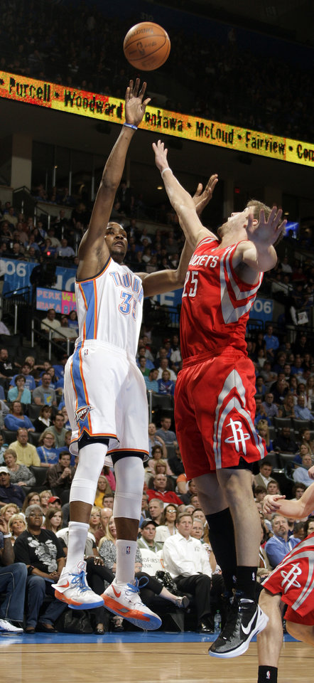 Oklahoma City's Kevin Durant (35) shoots over Houston's Chandler Parsons (25) during the NBA basketball game between the Oklahoma City Thunder and the Houston Rockets at the Chesapeake Energy Arena, Tuesday, March 13, 2012. Photo by Sarah Phipps, The Oklahoman.