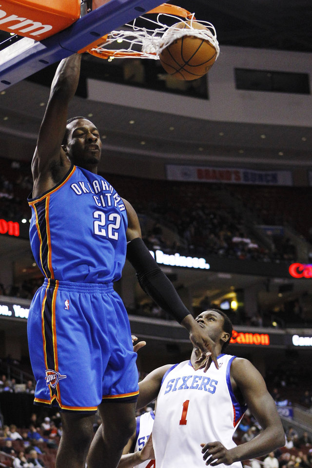 Photo - Oklahoma City Thunder's Jeff Green, left, dunks over Philadelphia 76ers' Samuel Dalembert in the first half of an NBA basketball game, Tuesday, March 30, 2010, in Philadelphia. Oklahoma won 111-93. (AP Photo/Matt Slocum) ORG XMIT: PXC113