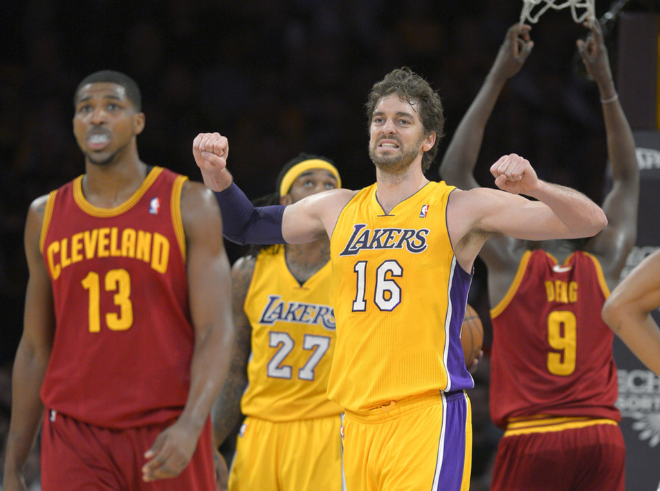 Photo - Los Angeles Lakers center Pau Gasol, of Spain, reacts after the Lakers turned over the ball, as Cleveland Cavaliers forward Tristan Thompson walks nearby during the first half of an NBA basketball game, Tuesday, Jan. 14, 2014, in Los Angeles. (AP Photo/Mark J. Terrill)