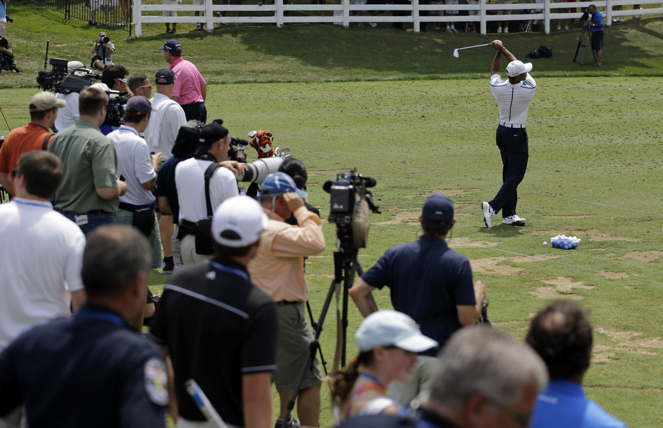 Photo - Tiger Woods warms up on the driving range before a practice round for the PGA Championship golf tournament at Valhalla Golf Club on Wednesday, Aug. 6, 2014, in Louisville, Ky. The tournament is set to begin on Thursday. (AP Photo/Jeff Roberson)