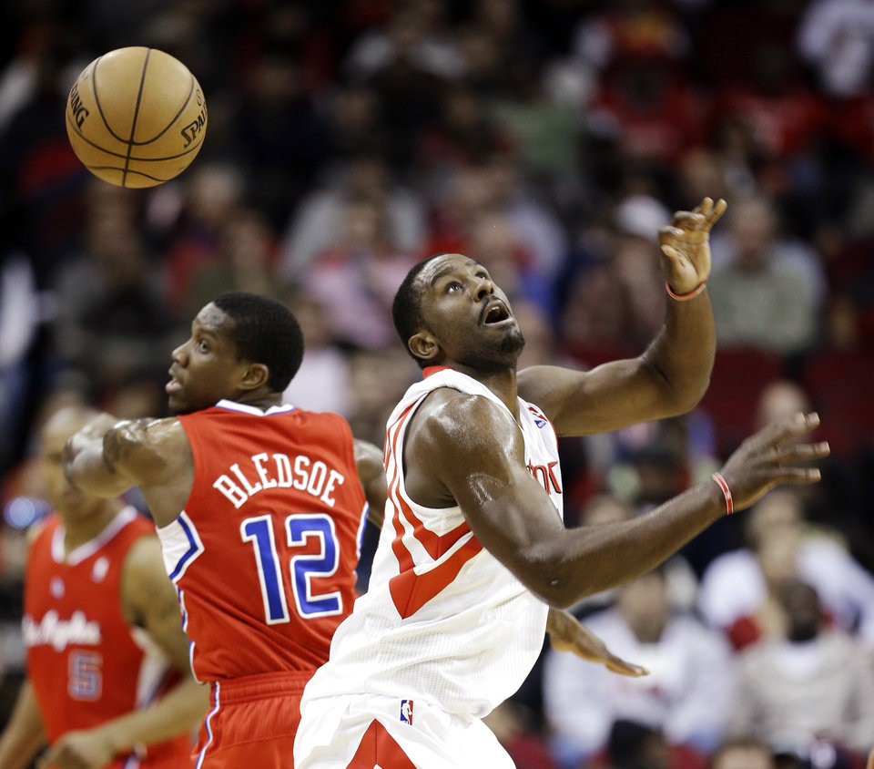 Houston Rockets' Patrick Patterson, right, loses the ball as Los Angeles Clippers' Eric Bledsoe (12) defends during the first quarter of an NBA basketball game, Tuesday, Jan. 15, 2013, in Houston. (AP Photo/David J. Phillip)