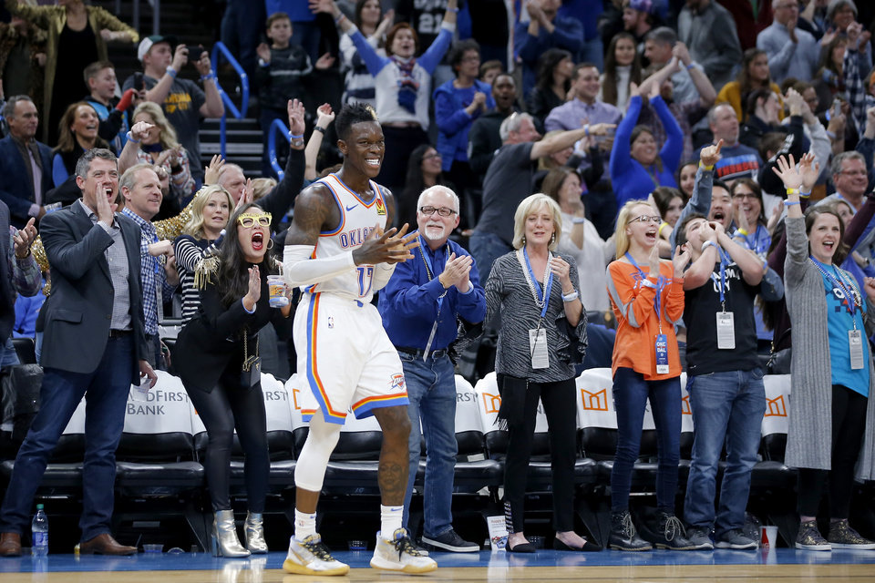 Photo - Oklahoma City's Dennis Schroder (17) smiles as fans cheer during an NBA basketball game between the Oklahoma City Thunder and the Dallas Mavericks at Chesapeake Energy Arena in Oklahoma City, Tuesday, Dec. 31, 2019. Oklahoma City won 106-101. [Bryan Terry/The Oklahoman]
