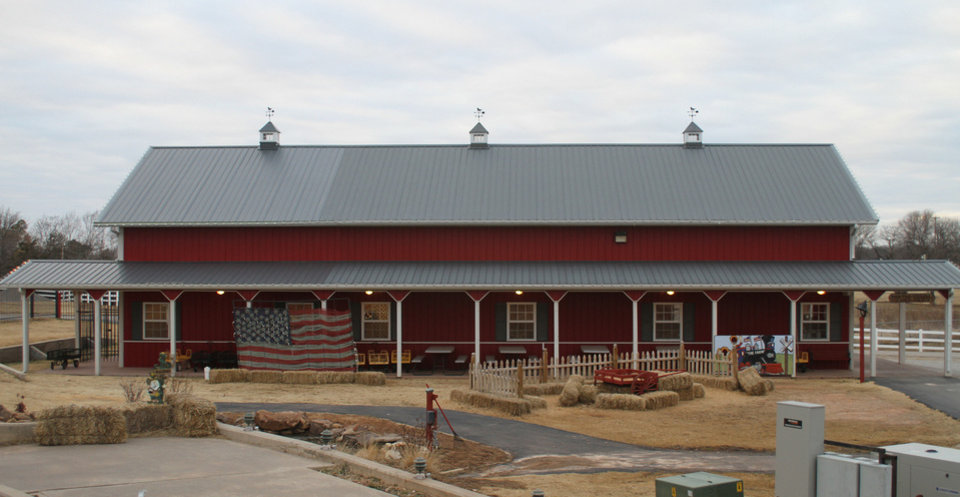 Photo - BEFORE: The Main Barn, pictured here a few months before the tornado hit it on May 20, was an event venue at the Orr Family Farm.. PHOTO PROVIDED.