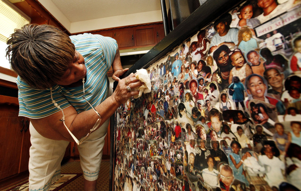 Photo - A collage that survived a tornado and a flood shows Willie Jean Yarbrough's family, which includes six children, 27 grandchildren and six great-grandchildren. PHOTO BY STEVE SISNEY, THE OKLAHOMAN  STEVE SISNEY