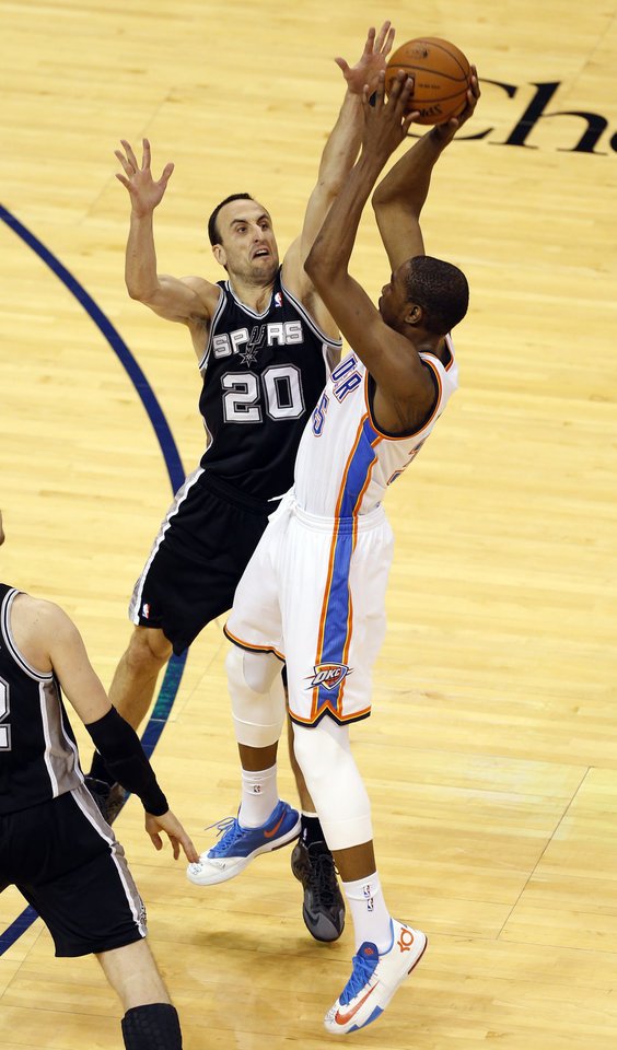 Photo - Oklahoma City's Kevin Durant (35) shoots over San Antonio's Manu Ginobili (20) during Game 6 of the Western Conference Finals in the NBA playoffs between the Oklahoma City Thunder and the San Antonio Spurs at Chesapeake Energy Arena in Oklahoma City, Saturday, May 31, 2014. Photo by Nate Billings, The Oklahoman