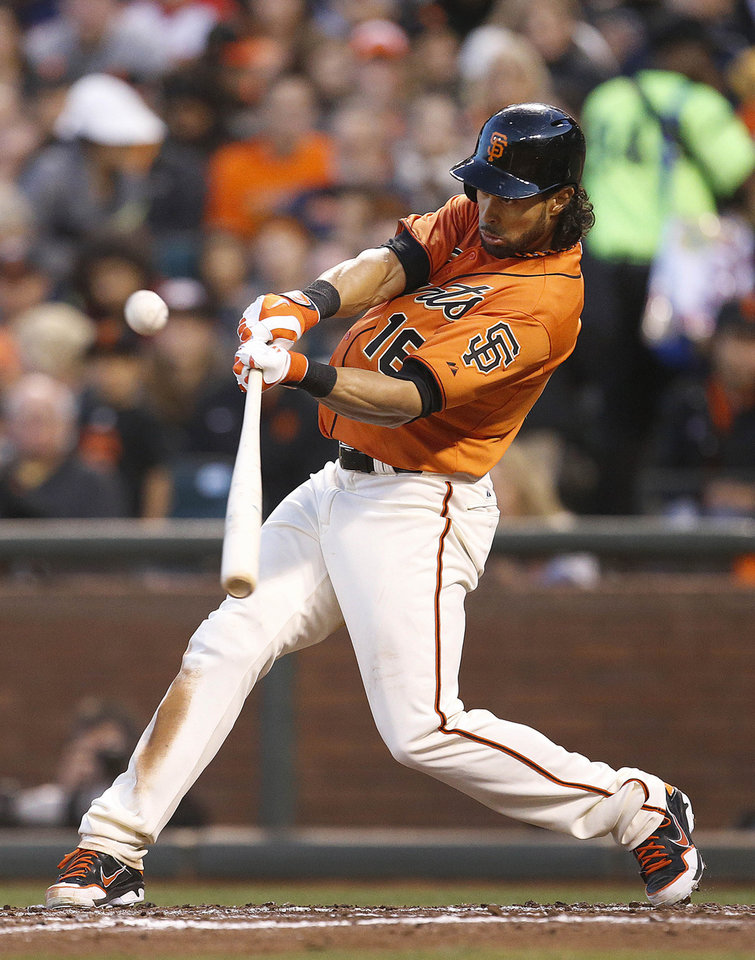 Photo - San Francisco Giants' Angel Pagan (16) hits a triple against the Minnesota Twins starting pitcher Kyle Gibson in the third inning of a baseball game Friday, May 23, 2014, in San Francisco. (AP Photo/Tony Avelar)