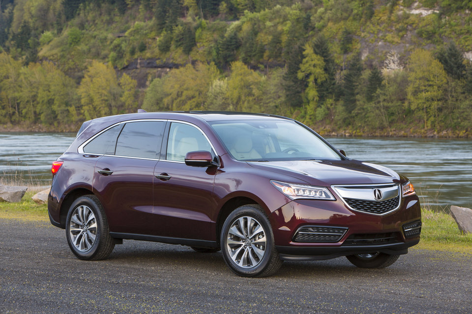 Photo - This undated image made available by Honda shows the 2014 Acura MDX. (AP Photo/Honda)
