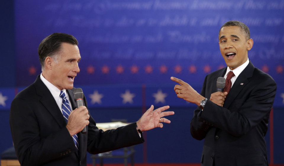 Photo - FILE - In this Oct. 16, 2012 file photo, President Barack Obama and Republican presidential candidate, former Massachusetts Gov. Mitt Romney exchange views during the second presidential debate at Hofstra University in Hempstead, N.Y. President Barack Obama will host his former political rival Mitt Romney for a private lunch at the White House Thursday, Nov. 29, 2012, their first meeting since the election.  (AP Photo/David Goldman, File)