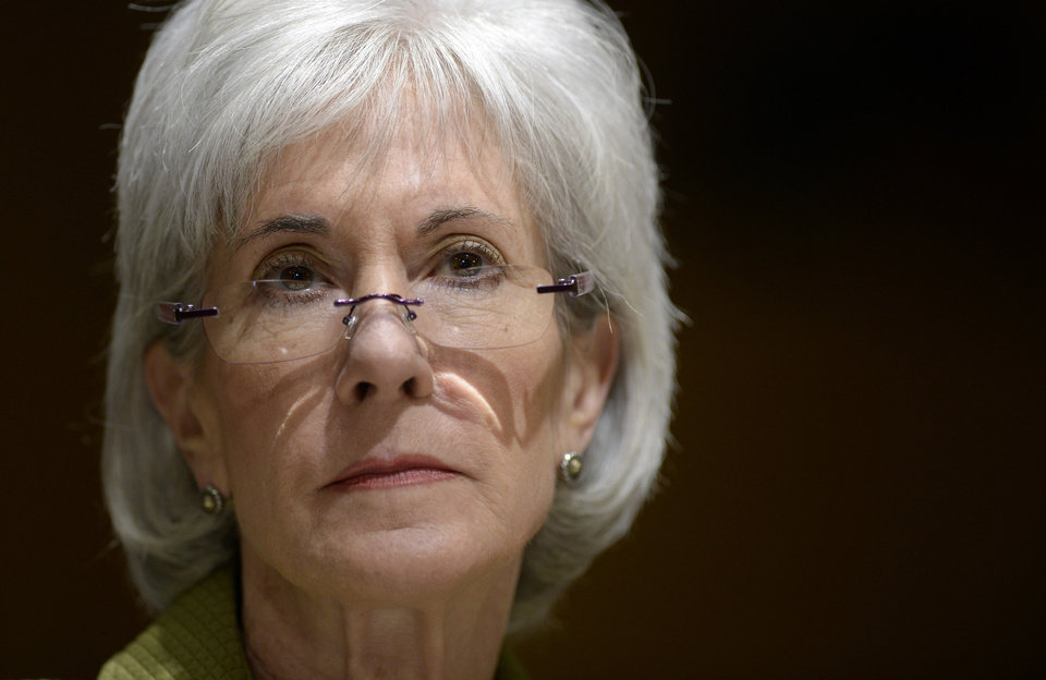 Photo - Health and Human Services Secretary Kathleen Sebelius listens as she testifies on Capitol Hill in Washington, Thursday, April 10, 2014, before the Senate Finance Committee hearing on the HHS Department's fiscal Year 2015 budget. A White House official says Sebelius is resigning from the Obama administration. The move comes just a week after the close of the rocky enrollment period for President Barack Obama's health care law. (AP Photo/Susan Walsh)