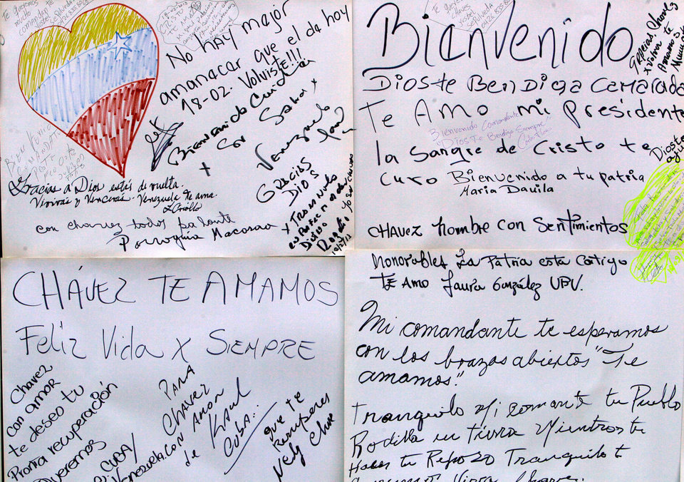 Welcome home and get well messages for Venezuela's President Hugo Chavez are taped to a board on a wall near Bolivar Square in Caracas, Venezuela, Monday, Feb. 18, 2013. Chavez returned to Venezuela early Monday after more than two months of treatment in Cuba following cancer surgery, his government said. Hundreds of Chavez supporters celebrated his return in downtown Caracas, chanting his name and holding photos of the president, in the nearby plaza. (AP Photo/Fernando Llano)