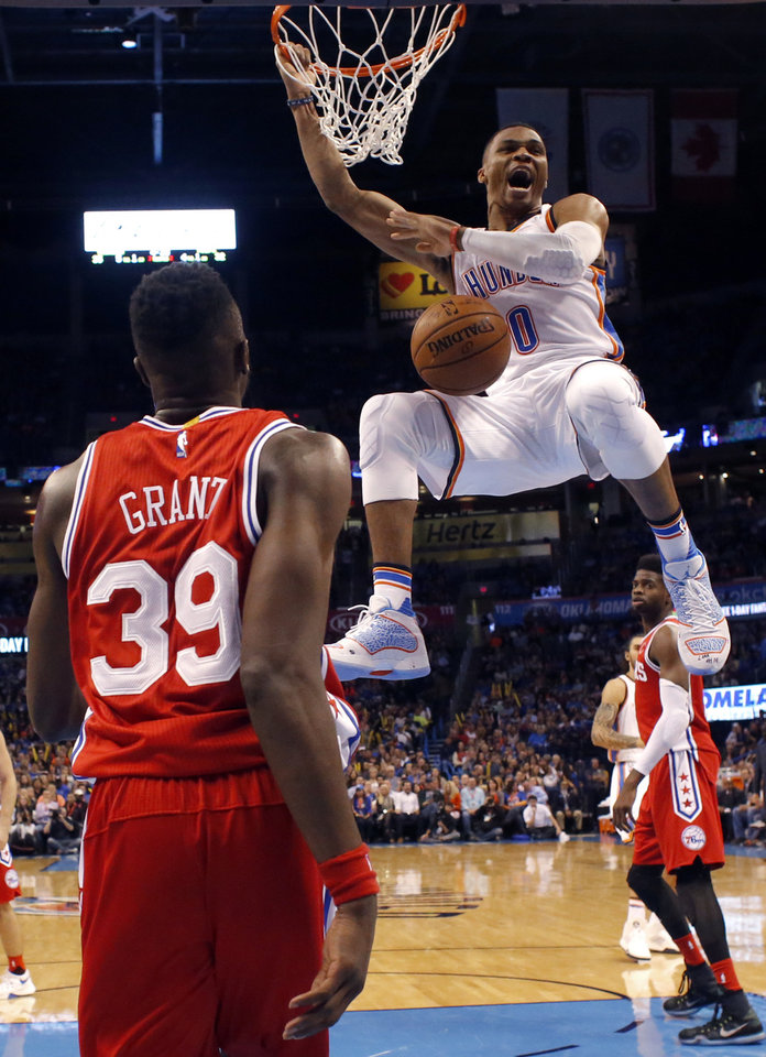 Photo - Oklahoma City's Russell Westbrook (0) reacts after a dunk in front of Philadelphia's Jerami Grant (39) during the NBA game between the Oklahoma City Thunder and the Philadelphia 76ers at the Chesapeake Energy Arena in Oklahoma City, Friday, Nov. 13, 2015. Photo by Sarah Phipps, The Oklahoman