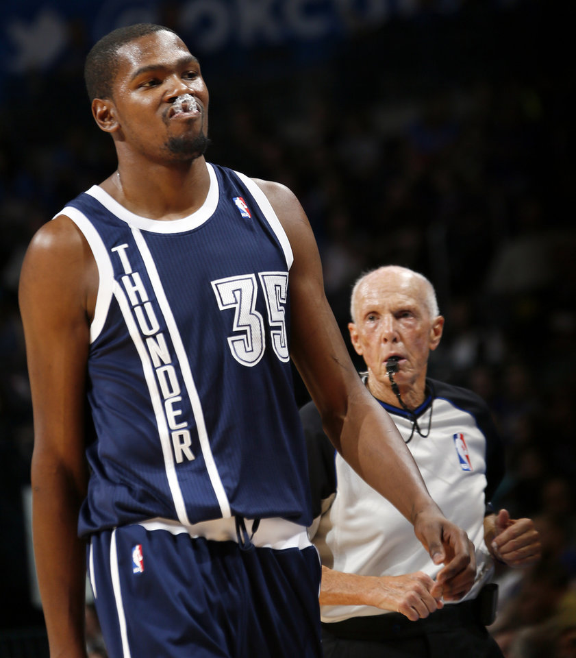 Photo - Oklahoma City's Kevin Durant (35) reacts in front of official Dick Bavetta during an NBA basketball game between the Detroit Pistons and the Oklahoma City Thunder at the Chesapeake Energy Arena in Oklahoma City, Friday, Nov. 9, 2012. Oklahoma City won, 105-94. Photo by Nate Billings, The Oklahoman