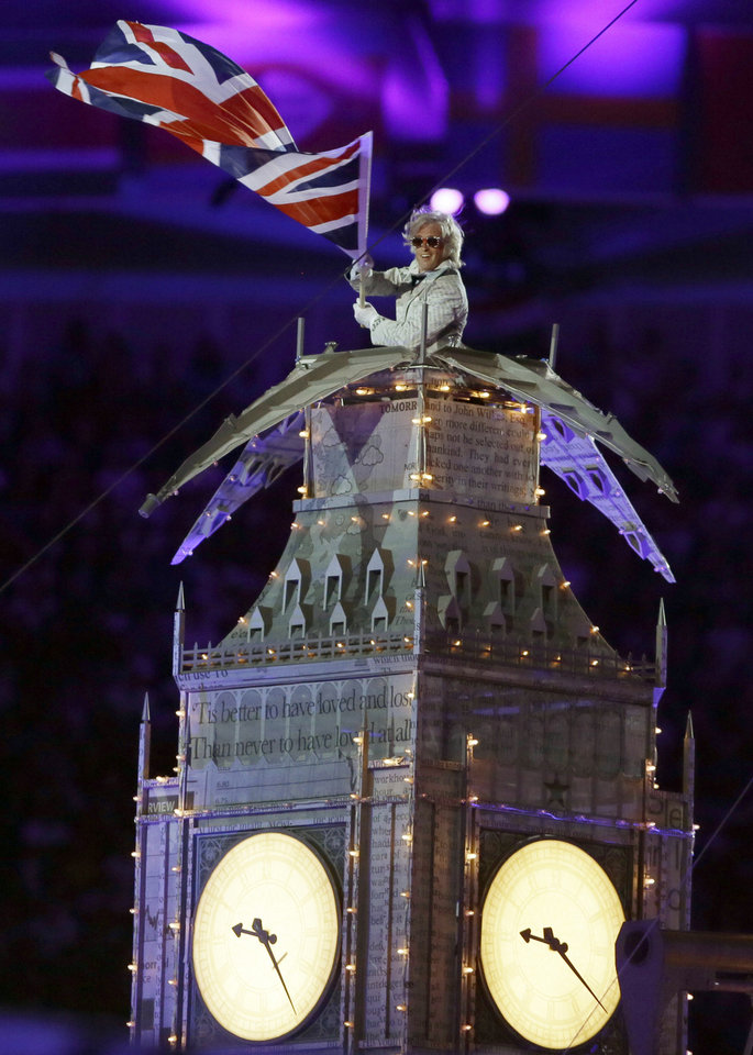 Photo -   A performer waves a British flag during the Closing Ceremony at the 2012 Summer Olympics, Sunday, Aug. 12, 2012, in London. (AP Photo/Kristy Wigglesworth)