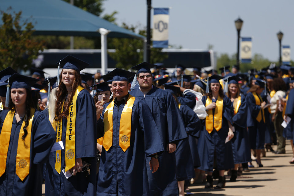Photo -  University of Central Oklahoma students gather for graduation ceremonies for College of Education and Professional Studies students. [PHOTO BY SARAH PHIPPS, THE OKLAHOMAN]