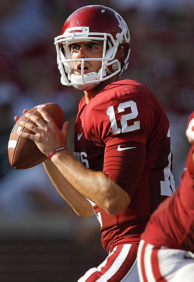 Oklahoma's Landry Jones (12) looks to throw the ball during the second half of the college football game between the University of Oklahoma Sooners (OU) and the Air Force Falcons at the Gaylord Family - Memorial Stadium on Saturday, Sept. 18, 2010, in Norman, Okla.   Photo by Chris Landsberger, The Oklahoman