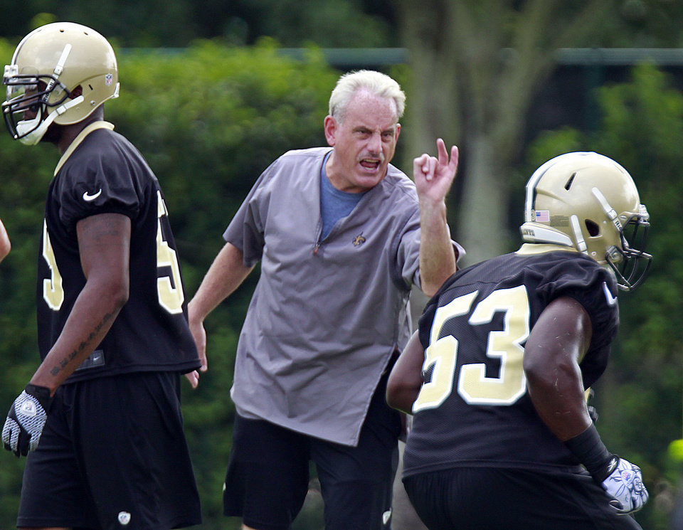 New Orleans Saints linebacker Lawrence Wilson (53) runs through drills at the direction of acting head coach Joe Vitt, center, practice at their NFL football training facility in Metairie, La., Thursday, May 31, 2012. (AP Photo/Gerald Herbert)