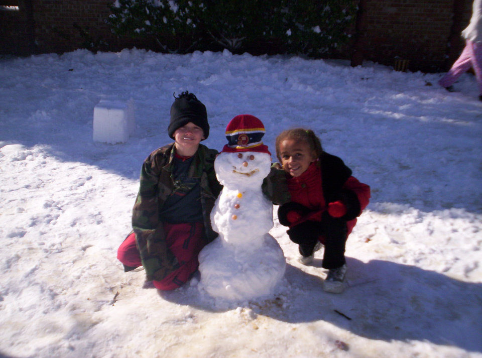 Kayla and Bobbie with their snowman<br/><b>Community Photo By:</b> Leah<br/><b>Submitted By:</b> Leah, Midwest City