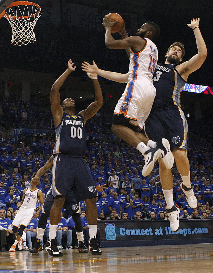 Oklahoma City's James Harden (13) goes to the basket between Darrell Arthur (00) and Marc Gasol (33) of Memphis during game two of the Western Conference semifinals between the Memphis Grizzlies and the Oklahoma City Thunder in the NBA basketball playoffs at Oklahoma City Arena in Oklahoma City, Tuesday, May 3, 2011. Photo by Bryan Terry, The Oklahoman