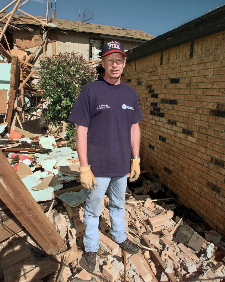Tornado victims, damage: Oklahoma City Assistant Fire Chief Jon Hansen by his house that was hit by the tornado.