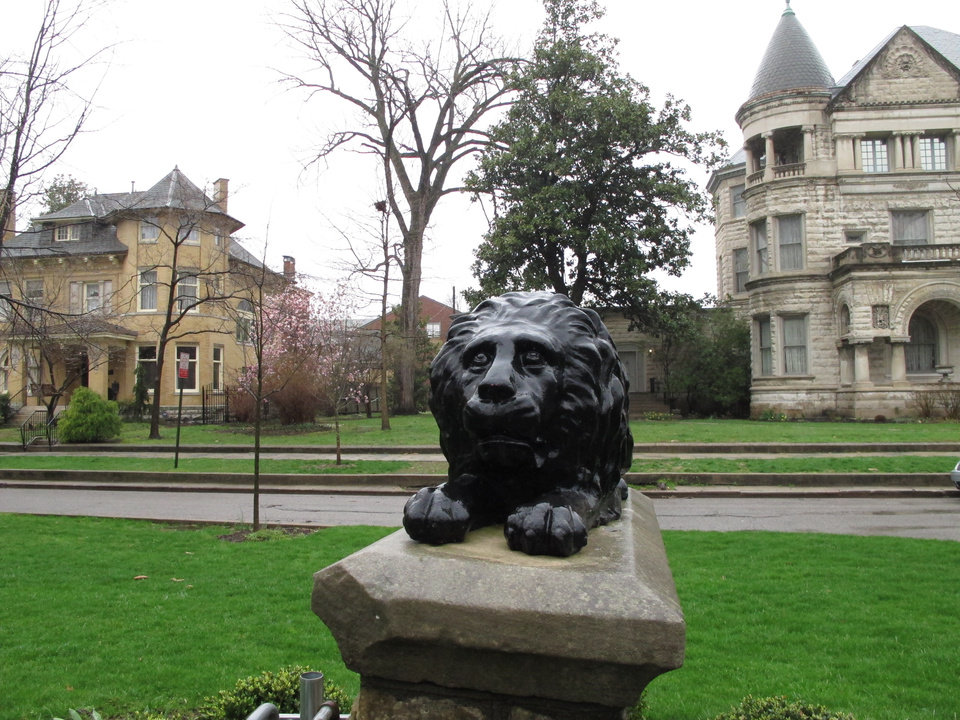 Photo - This April 3, 2014 photo shows a lion statute featured in a section of the Old Louisville neighborhood known for its stately Victorian homes. Old Louisville has undergone a revitalization that makes it a showcase in Kentucky's largest city. (AP Photo/Bruce Schreiner)