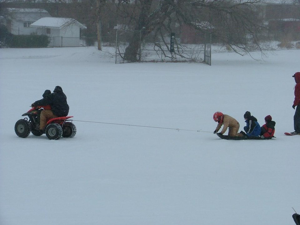 Roland Cherry and Ethan Blackstock pulling Hunter Blacksock,Elijah Blackstock and Travis Carpenter Ice Sledding Community Photo By: Amy Cherry Submitted By: Debbie, Midwest City