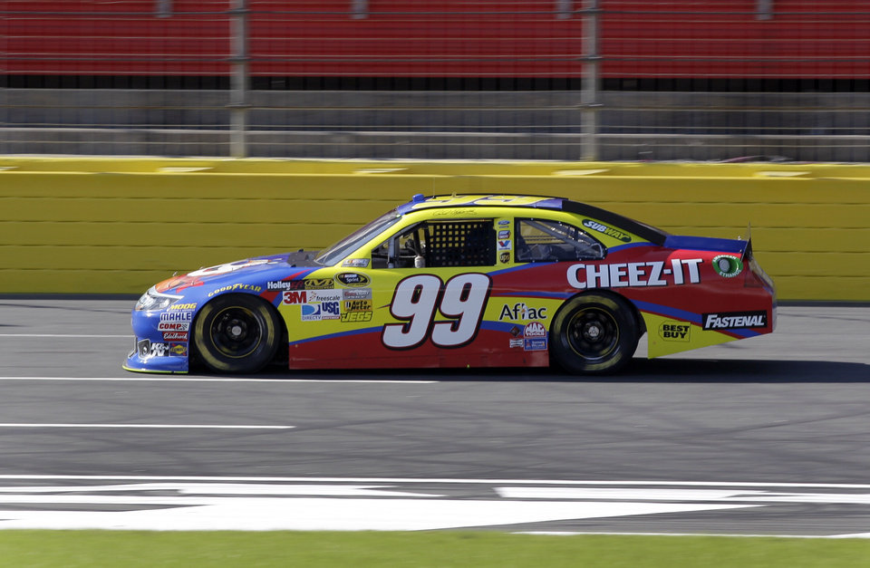 Photo -   Carl Edwards drives down the front-stretch during practice for Saturday's NASCAR Bank of America 500 Sprint Cup series auto race in Concord, N.C., Friday, Oct. 12, 2012. (AP Photo/Chuck Burton)