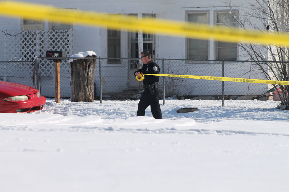 Photo - An Elk City woman was shot and killed on Wednesday morning, and her son was taken into police custody after police tased him in the snow. Photo by Derek Manning, Daily Elk Citian.  Derek Manning - Derek Manning, Daily Elk Citian