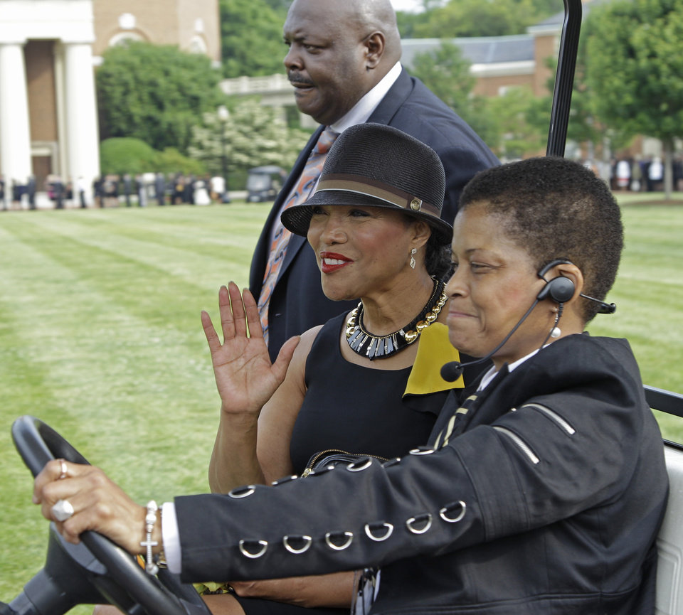 Photo - Actress Lynn Whitfield, center, waves as she arrive outside Wait Chapel before a memorial service for poet and author Maya Angelou at Wait Chapel. at Wake Forest University in Winston-Salem, N.C., Saturday, June 7, 2014. Former President Bill Clinton and Oprah Winfrey are joining First Lady Michelle Obama at the service. (AP Photo/Chuck Burton)